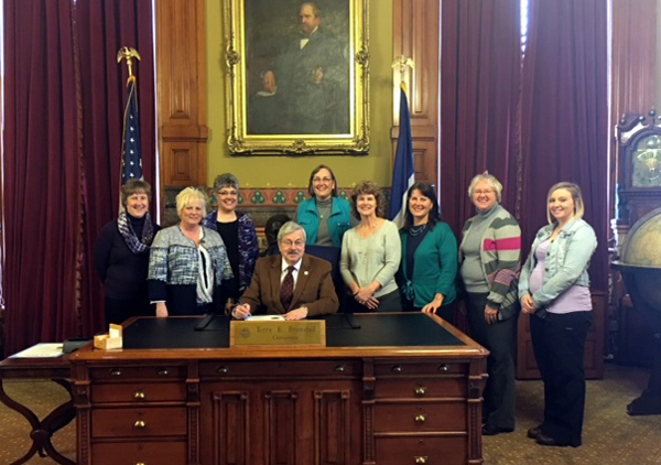 Signing with Governor Branstad